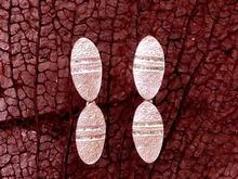 P.  ARRACADES dobles de 3,6 x 1 cm.
