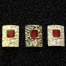 P. ARRACADES plata i bany d'or de 1,3 x 1,1 cms.